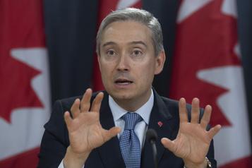 Le Canada suspend son traité d'extradition avec Hong Kong)
