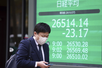 Les Bourses asiatiques clôturent en baisse, inquiétudes sur le front sanitaire)