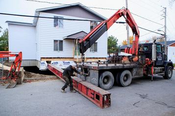 Levage de bâtiments: assez forts poursoulever desmaisons