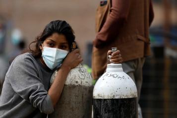 COVID-19 Les infections explosent en Asie, dit la Croix-Rouge)