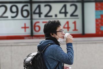 Les Bourses mondiales enthousiasmées par le recul des taux d'intérêt)