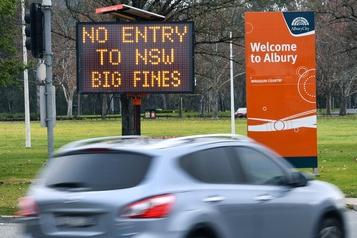 COVID-19: l'Australie reconfine Melbourne, flambée des cas aux États-Unis)