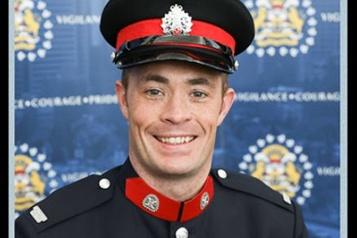 Policier de Calgary tué Deux jeunes adultes ont été arrêtés)