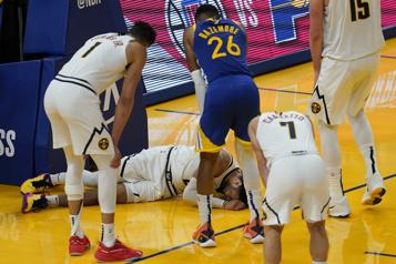 Jamal Murray a subi une déchirure du ligament du genou)