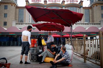 COVID-19: Pékin lève la plupart des restrictions aux déplacements)
