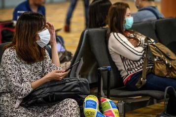 Virus chinois: 17 morts, les transports à l'arrêt au départ de Wuhan