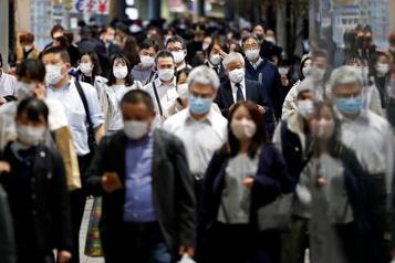 COVID-19 Le Japon en «alerte maximale» après un nombre record de cas)