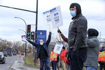 Port de Montréal Une loi spéciale met fin à la grève des débardeurs)