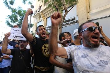 Les Libanais célèbrent le premieranniversaire de leur «révolution»)