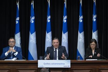 Encore «des mois» de distanciation sociale au Québec