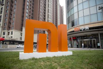 Le fabricant de téléphones Xiaomi se lance dans la voiture électrique)