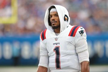 Cam Newton pense savoir pourquoi les Patriots l'ont libéré)
