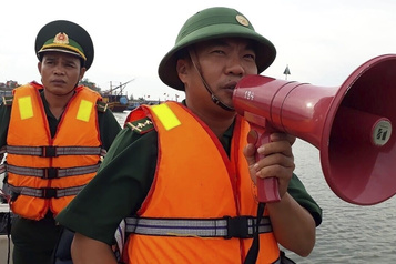 Vietnam Évacuations massives à l'approche du typhon Vamco)