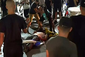 Tensions en Israël Le lynchage d'un homme présumément arabe diffusé à la télévision)