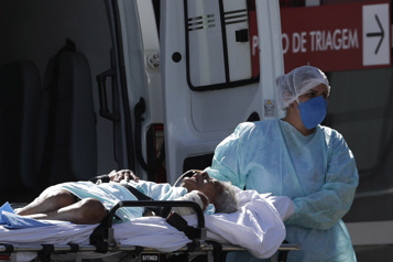 COVID-19 Nouveau record de décès en 24heures au Brésil: 1910 morts )