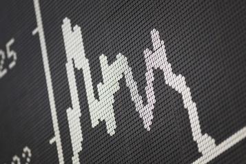 Wall Street réduit ses pertes, mais termine en baisse)