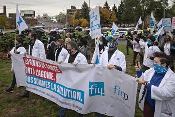Négociations avec Québec La FIQ perturbe la circulation à Montréal et Québec)