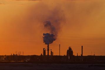 Industrie pétrolière et gazière Ottawa consacrera 100 millions à la réduction de l'impact environnemental)
