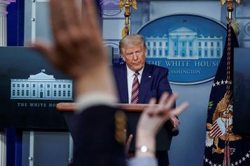 Trump sur la défensive à la veille de son débat crucial avec Biden)