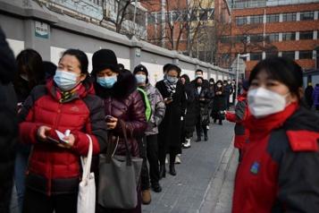 Dépistage massif à Pékin après quelques cas de COVID-19)