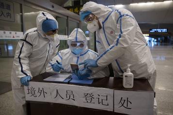 COVID-19: Wuhan, berceau de la pandémie, craint des cas importés
