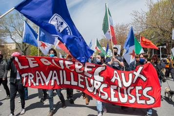 Marche du 1er-Mai Des travailleurs défilent dans les rues de Montréal)