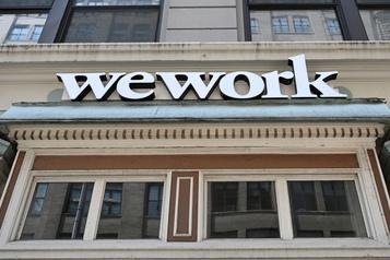 WeWork veut toujours entrer en Bourse cette année, réduit l'influence de son PDG