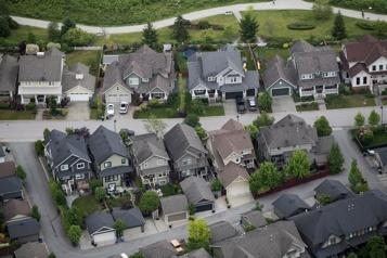 Immeubles résidentiels Taxer les acheteurs étrangers va générer 500 millions, selon le DPB)