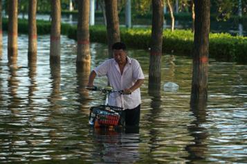 Chine Le bilan des inondations s'alourdit à 302morts)