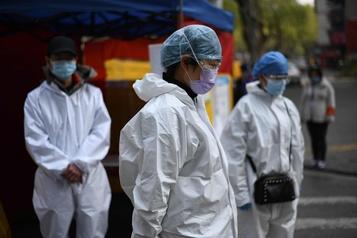 La Chine rend hommage à ses morts de la COVID-19