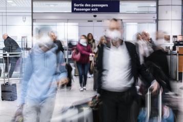 Variants et vols internationaux Trudeau doit «en faire plus», dit Legault )