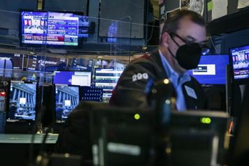 Bourses nord-américaines Le DowJones finit à l'équilibre, le NASDAQ à un record, le S&P/TSX en baisse)