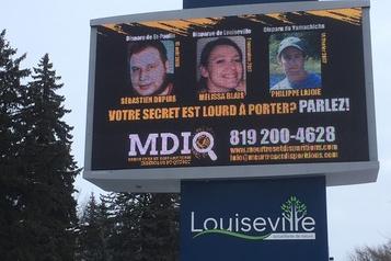 Des photos de personnes disparues à l'hôtel de ville de Louiseville