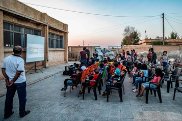 Syrie: un cinéma itinérant émerveille les enfants