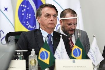 Brésil: sans-faute de Bolsonaro face au coronavirus, pour ses fidèles)