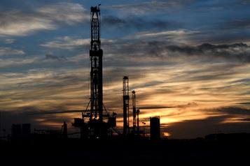 L'AIE abaisse les prévisions de demande de pétrole à cause des transports)