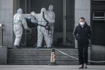 Chine: le virus transmissible entre humains, l'OMS convoque une réunion d'urgence