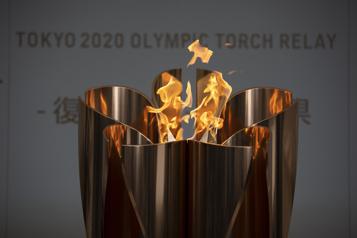Japon Des spectateurs mais pas d'acclamations pour le relais de la flamme olympique)