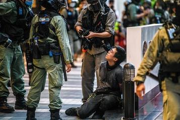 Premières arrestations à Hong Kong en vertu de la loi sur la sécurité)