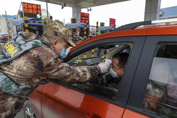 Virus en Chine: des villes entières en quarantaine