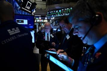 Les bourses américaines montent en réaction à l'accord partiel avec Pékin, pas Toronto