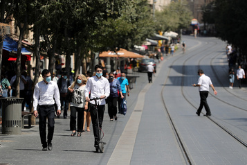 Déconfinement: Israël fait marche arrière après une flambée de cas)
