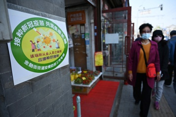 COVID-19 En Chine, des codes de couleur pour inciter les habitants à se faire vacciner)