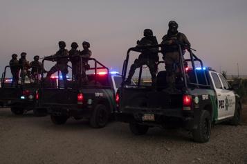 Mexique Des policiers déployés dans un camp de migrants haïtiens)