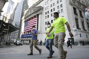 À Wall Street, le NASDAQ en retrait après plusieurs records)