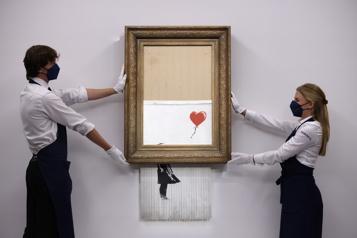 La toile auto-détruite de Banksy revient aux enchères en octobre)