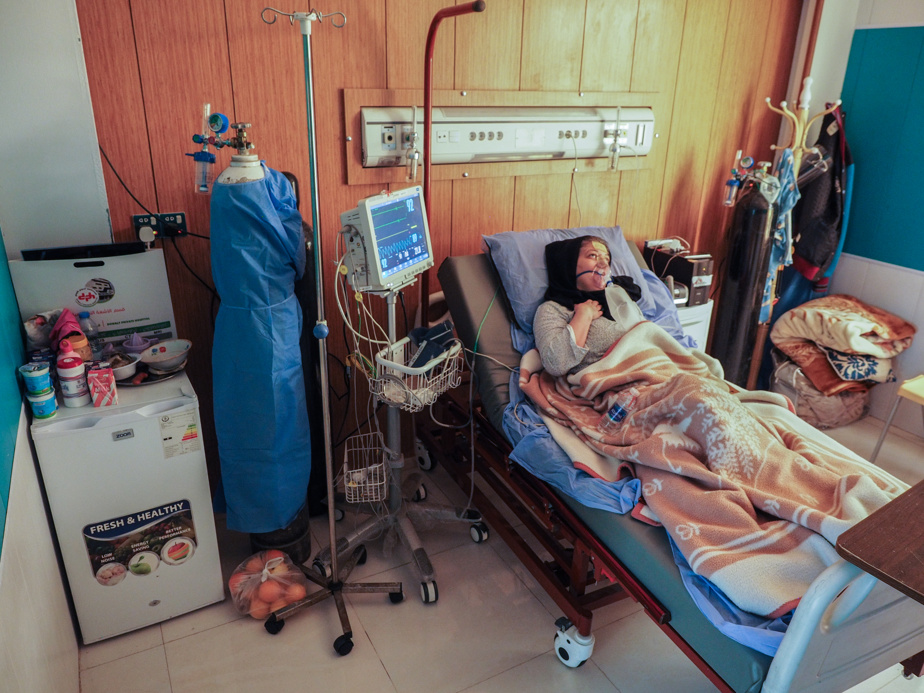 57-year-old Mayada Fadil in the intensive care unit.  She was admitted to the hospital 12 days ago.