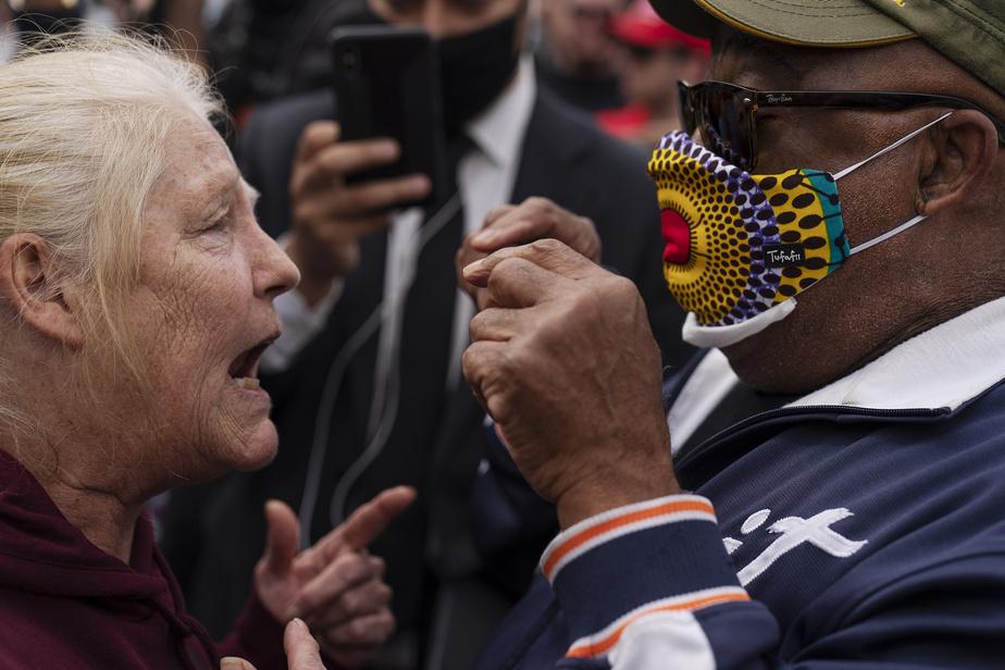 Affrontement verbal entre une partisane de Donald Trump et un contre-manifestant lors d'un rassemblement pro-Trump, à Detroit