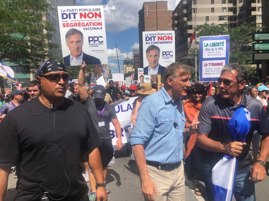 Maxim Bernier, leader of the People's Party of Canada, takes part in the protest.