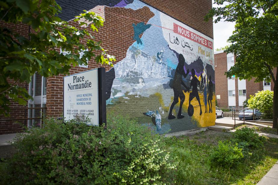 Nous sommes ici (2012), par Arnaud Grégoire, assisté de Cyril V, au 6320-6326, avenue Chartrand. Réalisée avec l'apport de la communauté, elle fait partie d'une série de trois œuvres murales peintes sur les murs de la Place Normandie, un ensemble d'habitations à loyer modique.